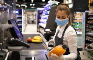 cashier wearing gloves